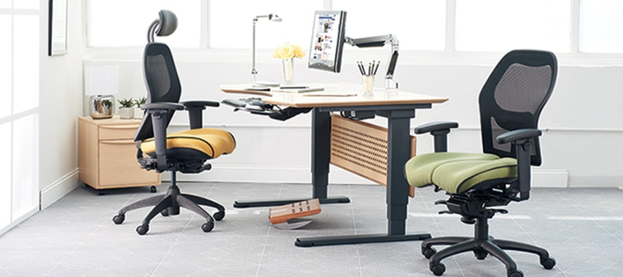 Ergonomic office design with chair, adjustable desk, and monitor arm